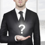 businessman holding question mark